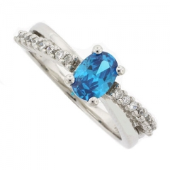 Oval Cut Blue Topaz Crossed Silver Ring
