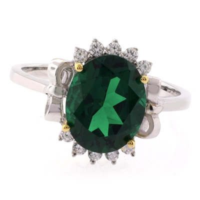 Beautiful Oval Cut Emerald Gold Prong Silver Ring