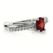 Oval Cut Ruby Crossed Silver Ring