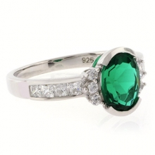 Oval Cut Channel Setting Emerald Ring