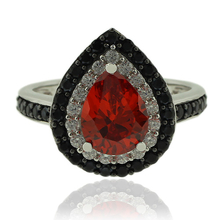 Sterling Silver Ring With Pear Cut Fire Opal and Simulated Diamonds