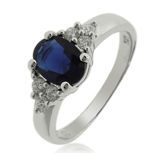 Elegant Silver Ring With Oval Cut Sapphire Gemstones and Simulated Diamonds