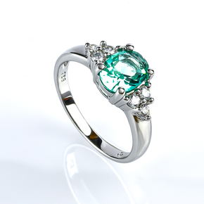 Elegant Silver Ring With Oval Cut Paraiba Gemstones and Simulated Diamonds