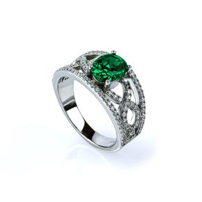 Oval Cut Emerald and Simulated Diamonds