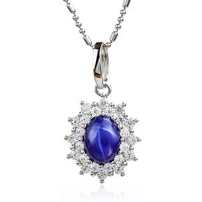Blue Star Sapphire Oval Cut Cabuchon Halo Pendant